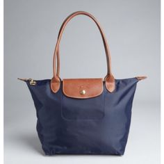 Longchamp Le Pilage tote- MEDIUM NAVY Medium navy long champ le Pilage bag. Authentic!! Has some wear and fraying on corners of the bag (as pictured) but no marks. Inside is also clean and in good condition as pictured! Willing to negotiate price through offer button & will post more pics if needed before purchase :) Longchamp Bags Shoulder Bags