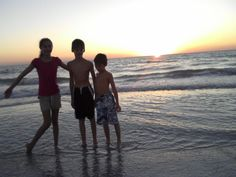 3 kids at sunset - 2010;  Indian Shores Beach
