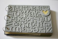 Glue chipboard letters to cardboard or book front & paint