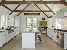Painted cabinets, wide-plank floors, beams @ Nancy Fishelson's former house | Boxwood Terrace