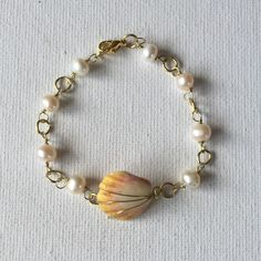 Made a sunrise shell gold wire link bracelet with freshwater pearls!