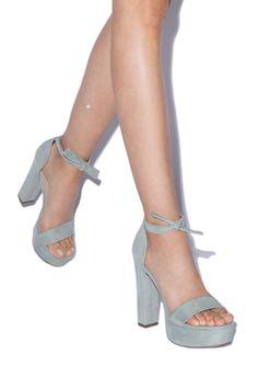 Block heel platform sandal with soft tie at ankle.