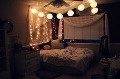 Bedroom 2 with string lights and faux canopy