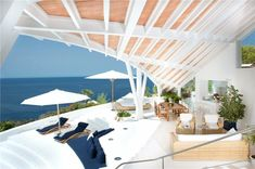 This beautiful villa was designed in 1996 by Spanish architect Alberto Rubio.  Renovated in 2008, the property is set overlooking the exclusive vicinity of Cala Marmacen in Puerto Andratx, Majorca.  Homes with stunning ocean views come with a price tag and this one is no exception, offered at €9.8 million!