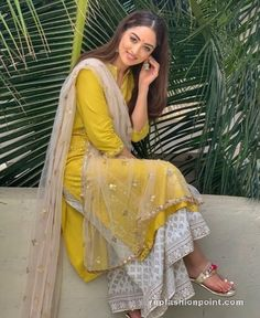 The sweet and cute actress Sandeepa Dhar is spreading desi vibes through her look. She is in a yellow kurta with white palazzo and dupatta set. Her simple and subtle look in this Indian traditional wear is full of beauty and grace Dress Indian Style, Indian Dresses, Indian Outfits, Indian Wedding Outfits, Emo Outfits, Pakistani Fashion Casual, Pakistani Dress Design, Pakistani Suits, Stylish Dress Designs