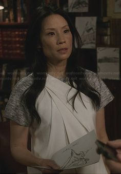 Joan's grey and white asymmetric wrap dress on Elementary.  Outfit Details: http://wornontv.net/24668/ #Elementary