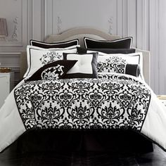 Love black and white bedding...but add a pop of color like Tiffany blue