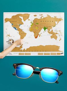 New Sunglasses & Scratch MapIt may not be the plane tickets to your dream destination, but this scratch world map from Uncommon Goods, and a new set of sunglasses are is a fun first step. You two wanderlust-ers will have a great time sitting down and picking out exactly where you both want to go and scratching off where you have been. After all, wishing, planning and dreaming are half the fun!