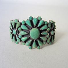 Vintage Turquoise Cuff Type of stone: Natural Green Turquoise (Possibly Kings Manassa)    Classic cluster cuff set in sterling silver with