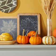 Detail of our Thanksgiving mantel with gourds, wheat, chalkboards and plates. More info: http://www.midwestliving.com/homes/seasonal-decorating/fall-decorating-1-mantel-3-ways/?page=8