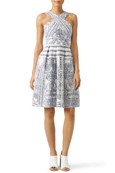 A chic pattern and crossed neckline make this Elliatt dress a standout. We love it with pointy-toe heels.