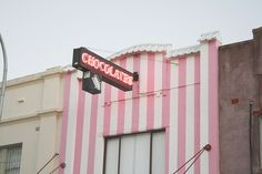A chocolate factory with pretty pink stripes on the wall. Pink Lady, Pastel Decor, Pastel Pink, Pink White, Hot Pink, Image Deco, I Believe In Pink, Photocollage, Pink Houses