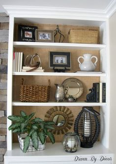 Add texture and warmth by placing burlap on the back of a white bookcase. I love how it highlights what's on the shelves! I also really like the molding to give the bookcase that built in look Styling Bookshelves, Decorating Bookshelves, Built In Bookcase, Bookcases, Bookshelves Around Fireplace, Rustic Bookshelf, Bookshelf Ideas, Bookcase Shelves, Family Room Fireplace