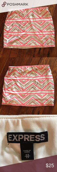 Express Mini Skirt XS This is an Adorable Mini Skirt with Sequins all over it with Bight Pink  let's just dive into Summer colors So fun! Fully lined and it's from Express too! Size XS. And it measures from waist to bottom 13 inches. Grab this one before it's gone Girls! Like New! Express Skirts Mini