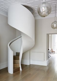 This spiral staircase made of oak treads and risers features an inset LED handrail. Modern Staircase, Staircase Design, Spiral Staircases, Stair Design, Staircase Ideas, Foyers, Oak Handrail, Stair Gallery, Tree House Designs