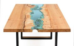 """richly-colored maple slabs modern black metal legs with wood inlayhand-cut blue glass silky smooth finish84"""" x 43"""" x 30""""*available in custom sizes*"""