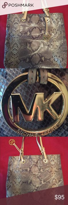 MK Snakeskin leather bag. This MK is authentic . It is leather snakeskin embossed. It is a large bag and can be carried as a tote or purse. Interior is perfect. Very GUC. See pictures. Michael Kors Bags Laptop Bags