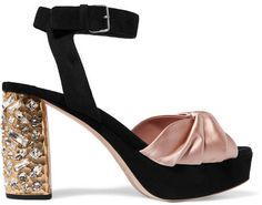 Miu Miu's black suede sandals have a textured gold heel that's embellished with light-catching crystals. The antique-rose satin front is folded to look like a bow, while the ankle strap provides comfort and support. Wear this outfit-transforming pair with bare legs and a mini skirt.