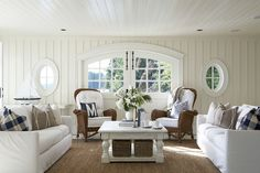 white and blue with wicker and paneled walls