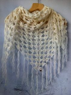 In this video tutorial you will learn how to crochet lovely triangle wrap / shawl. Made with a very soft fine-weight cream yarn. This is great for cool eveni...