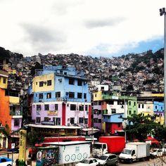 Travel guide: Favela Rocinha, Rio de Janeiro    The colourful facade of the favela. #travel #rio #brazil
