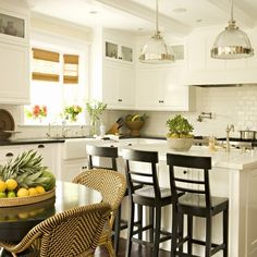 White granite is used on the island while black granite covers other workspaces. via Granite Gurus.