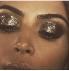 Kim Kardashian - make up by Mario Dedivanovic - shimmery silver eyelids and dewy bronzed foundation