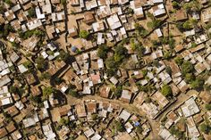 National Geographic: A poor neighborhood in urban Maputo. by National Geographic on artflakes.com as poster or art print $16.63