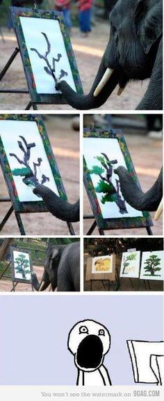 woah this elephant has way more talent than I do lol