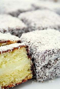 lamingtons filled with vanilla custard. this is a sponge cake with chocolate coating and custard filling.