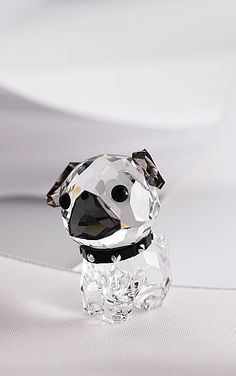 Puppy - Roxy the Pug wants to dance Rock nRoll with you! The combination of clear and dark crystal, together with black eyes and collar, adds a fas...