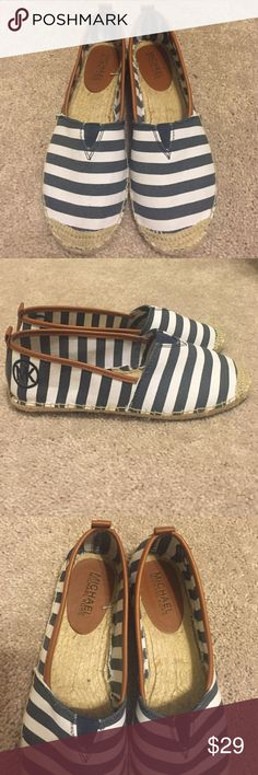 """Michael Kors Navy/White Striped Espadrilles """"Meg Slip On"""" Navy and white striped Michael Kors espadrilles. Slip-on, light, and comfortable. Worn once, excellent condition. Canvas fabric upper with leather trim, stitching detail around the bottom, and stitched MK circle logo on both shoes. Adorable for summer! Size stickers did come off on the bottom, but I know they are a 7M! Michael Kors Shoes Espadrilles"""