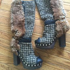 Authentic Chanel Tweed and Rabbit Fur hard to find These were my favorite boots and got the most compliments ever! Great condition.My friend who is a stylist snagged these for me. Very hard to find strait off the runway. Chanel Tweed & Fur Boots Black and camel tweed front. Fur back. Silver CC logo and stud trim. Black leather front toe &  tie accent. Wood platform and heel. Lugg sole. 37.5. I do not have the box, my kids decided one day they wanted to draw on most my shoe boxes and make…