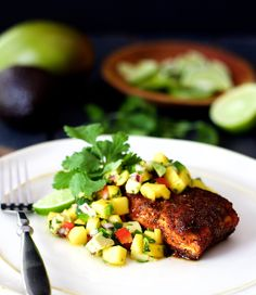 """Blackened Halibut with Mango and Avocado Salsa - Blackened Halibut with Mango and Avocado Salsa - The lightly charred crust that results from """"blackening"""" creates a pleasant contrast to this mild, flaky fish.  The fruity yet tangy salsa pairs perfectly!  Get the recipe at A Cookbook Obsession."""