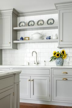 Light Gray And White Kitchen light gray and white kitchen boasts a farmhouse sink paired with a