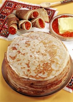 "The traditional #Russian festival of масленица [maslenitsa]. How to celebrate? First, we bake lots of блины (pancakes).  Although the word блин is typically translated as ""pancake"", it looks more like the French crepe. A very tasteful festival, #yamee!"