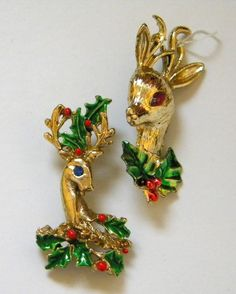Two Enameled Vintage Reindeer Heads with Holly Christmas Brooches.