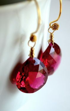 Luscious, lipstick-red earrings. From Kahili Creations of Hawaii...
