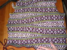 """From the pattern description: """"The diagonal bands of this sweater are created using Short Rows… The short Row segments skew the fabric to the bias, but after two segments the fabric levels out. The back and front are mirror images…"""""""
