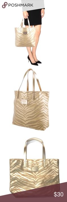 NWOT • Michael • Kors • Zebra • Print • Tote Gold zebra print tote with gold tone MK outside plate, metallic leather trim and tan woven interior lining. Tote is an open concept with a no zip closure. This was a gift with purchase of perfume which is considered an accessory that will have no serial number attached but is Authentic. 🔶Michael Kors. 🔶Condition • NWOT never used. 🔶Measurements • 17'W x 13'L with an 8' strap drop, which is approximate. 🔶Note • Tote in first 2 stock pics is…