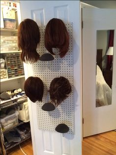 My current wig storage solution that I built on the inside door of my craft closet! Hair Product Storage, Hair Extensions Tutorial, Diy Wig, Arts And Crafts Storage, Inside Doors, Wig Stand, Business Hairstyles, Cosplay Diy, Girls Braids