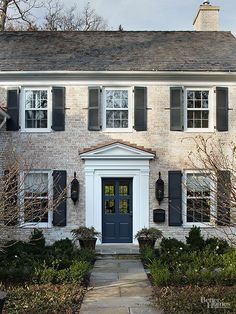 Timeless siding and a traditional style set the stage for this classic front door: http://www.bhg.com/home-improvement/exteriors/roofs/roof-designs-styles/?socsrc=bhgpin022415puretraditional&page=5