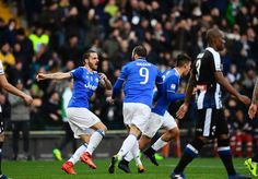 Juventus' Italian defender Leonardo Bonucci (L) celebrates with Juventus' forward from Argentina Gonzalo Higuain (C) and Juventus' forward from Argentina Paulo Dybala after scoring during the Italian Serie A football match Udinese vs Juventus at the Dacia Arena Stadium in Udine on March 5, 2017. / AFP PHOTO / MIGUEL MEDINA