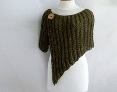 Knitted cape from thick melange black yarn. FREE by vinevirak
