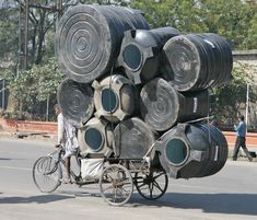 loaded down bicycles   ... bicycle in India. The burdened cyclists struggled past, loaded down