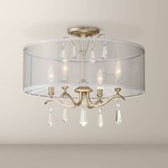 This decorative four-light ceiling fixture is a semi-flush delight in gold finish, crystals and a sheer drum shade. wide x 17 high. Canopy is 5 wide x high. Comes with of chain and of wire. Style # at Lamps Plus. Gold Ceiling Light, Low Ceiling Lighting, Ceiling Light Fixtures, Sloped Ceiling, Closet Chandelier, Lampshade Chandelier, Chandelier Shades, Room Lights, Drum Shade