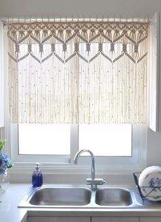 Macrame curtain in the kitchen window. I am doing this!!! Love!!!