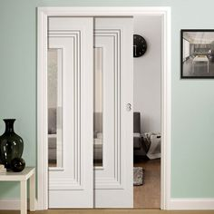 Twin Telescopic Pocket Atlanta White Primed Doors - Clear Glass.    #glazedpocketdoors #contemporarydoors #moderninteriordesign  #moderndoors  #hiddendoors