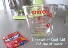 Dying Easter eggs using Kool-aid mix. Mix one pocket of Kool-Aid with 2/3 cup of water.