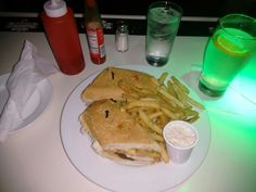 Grilled Chicken Sandwich with fries and coleslaw.